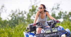 A young woman on an ATV